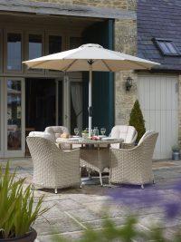 Bramblecrest Monterey 120cm Round Table with 4 Armchairs and Parasol - Sandstone