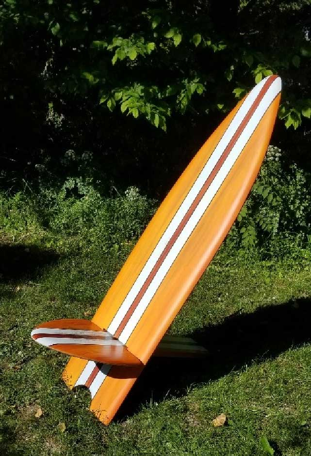 Surfboard Chair available in 1.5 and 1m sizes. Seat is detachable by sliding through the back rest. Made from MDF, painted and sealed, not suitable for leaving outside but very easy to store. Makes a fun colourful statement in the garden.